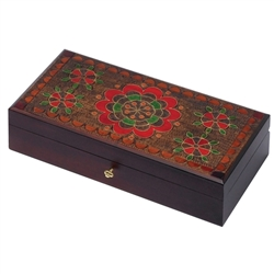 This box features a brightly colored floral design accented with metal inlay and set against a carved, burned texture background. Box has a locking mechanism and comes with a key. Handmade in the Tatra Mountain region of Poland.