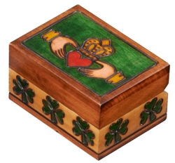 The lid of this wooden box is decorated with an Irish claddaugh design, representing friendship, love and loyalty. The sides of the box feature green shamrocks. Handmade in Poland's Tatra Mountain region.