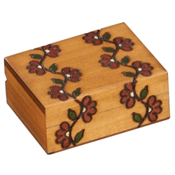 The motif of flowering vines wraps around this beautiful box. Handmade in Poland's Tatra Mountain region.