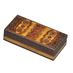 Highly detailed brass inlay and hand carving dominate the top and sides of this box. Geometric swirls and ellipses. Hinge lid. Handmade in Poland's Tatra Mountain region.