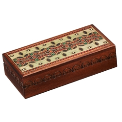 This box features a beautifully detailed leaf design in muted shades. Brass inlays in the lid and carvings along the side of the box complete the item. The box is handmade in the Tatra Mountain region of Poland.  Handmade in Poland's Tatra Mountain region
