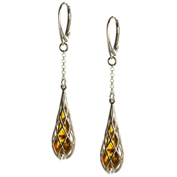 Honey amber drop tear earrings enclosed in silver webbing with European lever back fittings. Amber is soft, only slightly harder than talc, and should be treated with care.