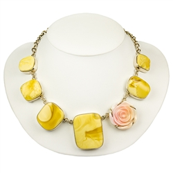 This beautiful set is composed of custard Baltic amber and rare Mediterranean hand carved pink conch (strombus).