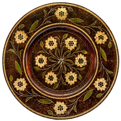 Hand Made in Nowy Sacz, Poland Polish wooden plates are made from Linden wood in the mountain region of southern Poland called Podhale. The plates are cut and shaped on a lathe by hand. The floral designs are burned into the wood then painted after staini