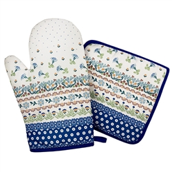 Colorful set of decorative mitt and holder set featuring a traditional Polish stoneware design. 100% polyester.  These mitts are more decorative than useful as they do not have effective insulating material. Decorative only - not intended to handle heat.