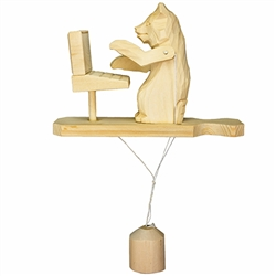 Wooden spin toy from Russia that will bring smiles to all who try it! This bear is working on his computer. A perfect example of an old fashioned action toy. Hand made traditionally by parents and grandparents for their children. a wonderful toy, that's