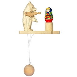 Wooden spin toy from Russia that will bring smiles to all who try it! This bear is painting a matryoshka doll. A perfect example of an old fashioned action toy. Hand made and painted. Traditionally made by parents and grandparents for their children that