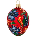 "Sparkling glitter accents combine with a beautiful flower design on a radiant red satin background to create this egg-ceptionally egg-citing ornament! Blooming with a unique blend of springtime splendor and Christmas charm, this 2¾"" tall red flowered egg"