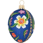 "Truly egg-traordinary, this gorgeous glass design is artfully hand-painted with a myriad of vibrant glazes and subtle touches of glittering gold. Masterfully crafted in Poland by artisans, our 2½"" tall blue painted egg ornament with flowers is simply egg-"