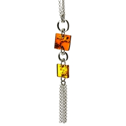 Two squares of amber suspended on a fine silver chain.