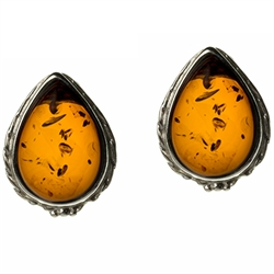 "Artistic tear drop shaped silver earrings with a center of honey colored amber. Size approx .6"" x .5""."
