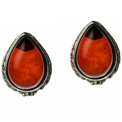 Artistic tear drop shaped silver post back earrings with a center of cherry colored amber.