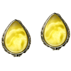 Artistic tear drop shaped silver post back earrings with a center of custard colored amber.