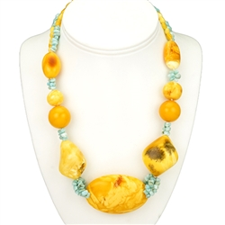 Bozena Przytocka is a designer of artistic amber jewelry based in Gdansk, Poland.   Here is a beautiful example of her ability to blend Baltic Amber and Larimar from the Dominican Republic to create a stunning necklace.