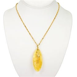 "Beautiful custard amber cabochon suspended on a 14k finding.  18"" long 14k gold filled chain."