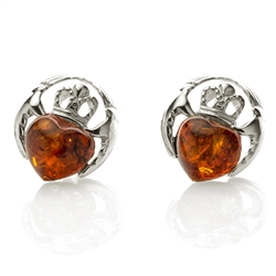 Its shape is enough to convey the message that it bears - two hands holding an amber heart, which has a silver crown on its head. It is said that Claddagh upholds the emotions of love, friendship, loyalty, and affection.