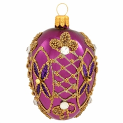 Impeccably detailed, this gorgeous purple egg ornament is intricately patterned with egg-squisite gold glitter designs. Masterfully hand-crafted of glass in Poland