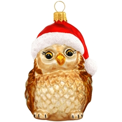"Christmas is a hoot with this adorable owl ornament! Featuring sparkling iridescent glitter accents, our charming bird is made in Poland of mouth-blown glass and hand-painted by skilled artisans. Measuring 3¼"" tall, this owl with Santa hat ornament will"