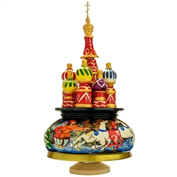 "This beautiful music box made in the shape of Saint Basil's Cathedral is constructed of seasoned Linden wood. Hand painted winter scene around the base. Winding the cathedral clockwise plays the popular Russian melody, ""Midnight In Moscow""."