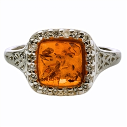Beautifully designed classic silver setting for these honey amber stone surrounded by Cubic Zirconia crystal.