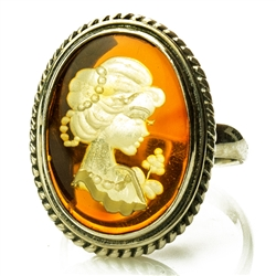 Unique and lovely honey amber cameo set in sterling silver. ! The exquisitely detailed cameo is hand-carved from the reverse side of the amber.