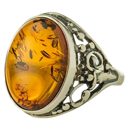 "Nice-sized oval honey amber set in sterling silver. Size approx .75"" x .5""."
