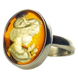 Unique and lovely honey amber cameo set in sterling silver.