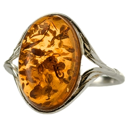 "Medium size honey oval amber set in sterling silver.  Size approx .75"" x .5""."