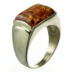 "A perfectly cut rectangular piece of cognac colored amber set in sterling silver.  Size approx .75"" x .5""."