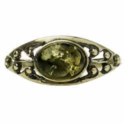 "A small oval of green color amber set in a classic sterling silver setting. Size approx .25"" x .4"""