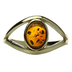 "Honey colored amber ""eye"" set in sterling silver.  Size approx. .5"" x .25""."