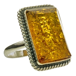 "A perfectly cut rectangular piece of honey colored amber set in sterling silver.  Size approx 1"" x .75"""