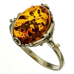 A nice size amber cabochon framed in a classic sterling silver frame.