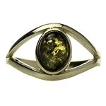 "Green colored amber ""eye"" set in sterling silver. Size approx. .5"" x .25"".