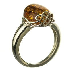 A beautiful oval amber cabochon set in sterling silver with a Celtic design.