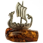 "Our little sterling silver Viking ship is traveling on a sea of amber.  Nicely detailed. Approx size 1.5"" x 1.25"" x 1.75""."