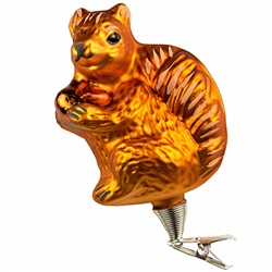 "Don't squirrel away this cute keepsake……display it for all to see! Hand-painted with shimmering glazes and sparkling gold accents, our 4"" tall squirrel with acorn glass ornament comes ready to hang with a gold cord will add a natural touch to your tree!"
