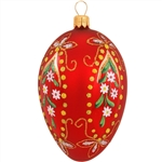 "Truly eggceptional, this gorgeous glass design is artfully hand-painted with a myriad of vibrant glazes and shimmering glitter accents. Masterfully crafted in Poland, our 3½"" tall red egg ornament with flower designs is simply egg-quisite!"