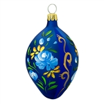 "Italian craftsmanship is evident in this egg-ceptional design! Hand-painted with a vibrant mix of colorful florals and stripes, our 2½"" tall blue glass egg is sure to enhance your décor for many seasons to come"