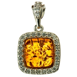 Beautifully designed classic silver setting for these honey shaded amber stones surrounded by Cubic Zirconia crystals