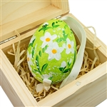 Hand painted duck egg nested inside a hand painted wooden box with a matching floral scene. The duck egg is blown out and comes with a ribbon hanger. Magnetized lid. Hand made so no two eggs or boxes are exactly the same.