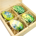 Hand painted goose eggs featuring Polish floral scenes and nested inside a hand painted wooden box with a matching floral scene.  The goose eggs are blown out  and come with a ribbon hanger.  Magnetized lid.  Hand made so no two eggs or boxes are exactly