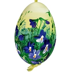This beautiful hand painted goose egg comes ready to hang. The eggs have been emptied and strung through with ribbon for hanging. No two eggs are exactly alike and ribbon colors vary as well.