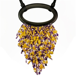Bozena Przytocka is a designer of artistic amber jewelry based in Gdansk, Poland. Here is a beautiful example of her ability to blend amber and amethyst to create a stunning necklace. The straps are leather and the  centerpiece is ebony.  The longest bead