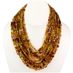 Bozena Przytocka is a designer of artistic amber jewelry based in Gdansk, Poland. Here is a beautiful example of her ability to blend amber and peridot to create a stunning necklace.