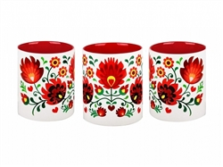 Colorful ceramic mug featuring a Polish paper cut pattern. Made in Poland.