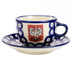 Boleslawiec tea cup and saucer set featuring the Polish Eagle on a red crest. Made by the Manufaktura company. Signed by the artist.