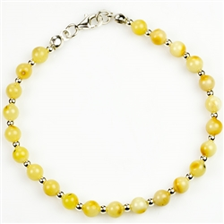 Circular custard amber and silver beads with sterling silver claw clasp.
