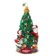 The Clauses make the perfect couple as they decorate for the biggest party of the year! You'll smile in delight as you decorate your own Christmas tree with this Christopher Radko ornament that features a tree embellished with candles and garlands.