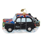 You'll not miss a beat in this dashing cab! The Beatles are zipping around London in their very own black taxi, carrying their instruments to the next gig. They even brought along their very own record player, just in case they want to listen to a few tun